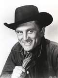 Kirk Douglas smiling in Cowboy Outfit Photo by  Movie Star News