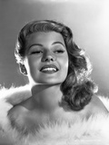 Rita Hayworth smiling with Fur Shawl Photo by  Movie Star News
