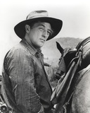 Robert Mitchum Posed in Western Outfit Photo by  Movie Star News