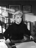Anne Francis sitting in Black Sweater Photo by  Movie Star News