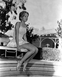 Hayley Mills sitting in Printed Dress Photo by  Movie Star News