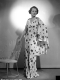 Mary Astor on Printed Dress standing Photo by  Movie Star News