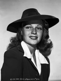 Rita Hayworth Posed with a Black Hat Photo by Ned Scott