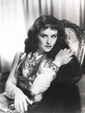 Paulette Goddard sitting Portrait Photo by  Movie Star News