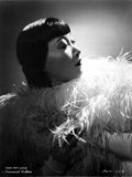 Anna Wong Using a Feather Scarf Photo by  Movie Star News
