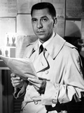 Jack Webb Posed in Coat With Paper Photo by  Movie Star News