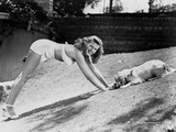 Rita Hayworth Sexy Pose with a Dog Photo by  Movie Star News