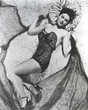 Rhonda Fleming Lying on a Carpet Photo by  Movie Star News