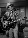 Gene Autry Playing the Guitar Photo by  Movie Star News