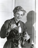 Joan Fontaine Lighting a Candle Photo by  Movie Star News