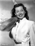 Gail Russell smiling in White Photo by  Movie Star News
