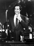 Chevy Chase smiling in Black Suit Photo by  Movie Star News