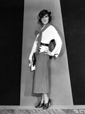 Mary Brian standing in White Coat Photo by  Movie Star News