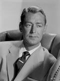 Alan Ladd sitting on a Bucket Seat Photo by  Movie Star News