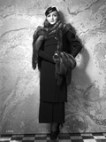 Nancy Carroll standing in Classic Photo by  Movie Star News