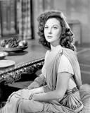 Susan Hayward sitting in a Dress Photo by  Movie Star News