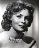 Rhonda Fleming smiling in Portrait Photo by  Movie Star News
