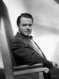 Orson Welles Seated in Formal Suit Photo by E Bachrach