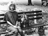 Rosanna Arquette Seated on Couch Photo by  Movie Star News