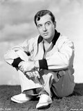 John Payne sitting in Classic Photo by  Movie Star News