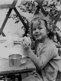 Shirley Temple Eating in Sweater Photo by  Movie Star News