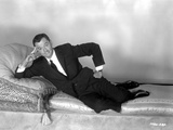 Tony Randall Lying in Black Suit Photo by  Movie Star News