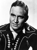 Gene Autry Posed in Cowboy Outfit Photo by  Movie Star News