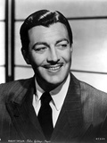 Robert Taylor Grinning in Suit Photo by  Movie Star News