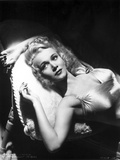 Carole Landis Lying on a Couch Photo by  Movie Star News