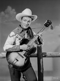Roy Rogers Playing a Guitar Photo by Jack Freulich