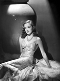 Nina Foch Seated in Silk Dress Photo by  Movie Star News