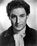 Robert Donat in Black Suit Photo by  Movie Star News