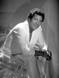 Tom Jones sitting in White Suit Photo by  Movie Star News