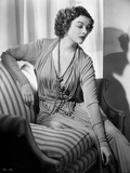 Myrna Loy posed on Couch Photo by E Bachrach