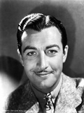 Robert Taylor smiling in Suit Photo by  Movie Star News
