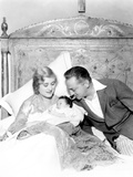 John Barrymore Looking at Baby Photo by  Movie Star News