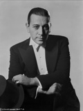George Raft Posed in Black Suit Photo by AL Schafer