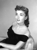 Ann Blyth sitting and smiling Photo by  Movie Star News