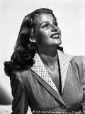 Rita Hayworth smiling in Blazer Photo by A.L. Schafer
