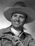 Gene Autry Holding a Rope Photo by  Movie Star News