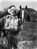 Gene Autry smiling in Photo Photo by  Movie Star News