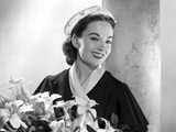 Ann Blyth Carrying a Flower Photo by  Movie Star News