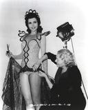 Ann Miller Fixing Her Dress Photo by  Movie Star News