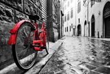 Retro Vintage Red Bike on Cobblestone Street in the Old Town. Color in Black and White. Old Charmin Fotografie-Druck von Michal Bednarek