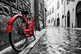 Retro Vintage Red Bike on Cobblestone Street in the Old Town. Color in Black and White. Old Charmin Fotografie-Druck von PHOTOCREO Michal Bednarek