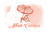 North Carolina - Beach Chair and Umbrella - Coral - Coastal Icon Prints by  Lantern Press