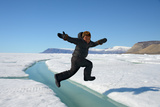 Young Inuit Boy Jumping over a Crack on Ice Floe, Ellesmere Island, Nanavut, Canada, June 2012 Photographic Print by Eric Baccega