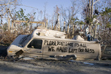 Note Written by Hurricane Katrina Victims on Vehicle Damged by Hurricane Photographic Print by John Cancalosi