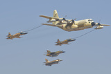 A Royal Moroccan Air Force Kc-130 Refueling a Pair of F-5 Aircraft Photographic Print by  Stocktrek Images