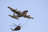 An Israeli Air Force Kc-130H Karnaf Refuels a Ch-53 Yasur Helicopter Photographic Print by  Stocktrek Images